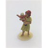 Figure: woman, yellow dress holding child Omen 1:43